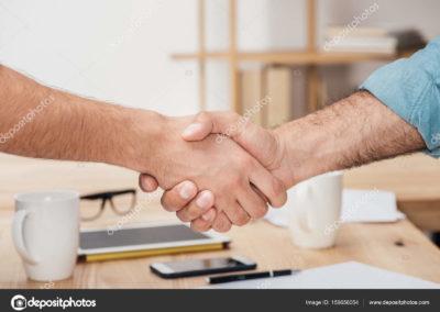 depositphotos_159656054-stock-photo-businessmen-shaking-hands